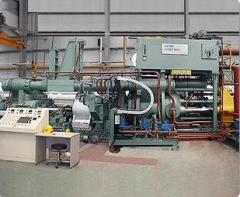 Press for shock extrusion and sintering of metal